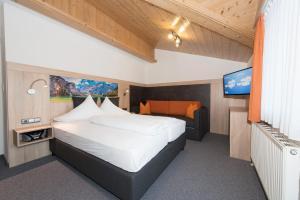 Letto o letti in una camera di Appartements Schneezauber