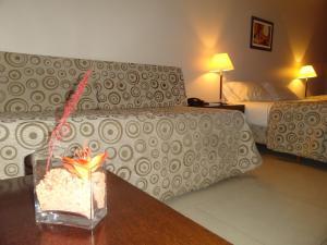 Una cama o camas en una habitación de Gala Apart & Suites
