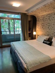 Una cama o camas en una habitación de Great Studio Palermo Hollywood