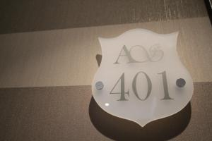 The logo or sign for the apartment