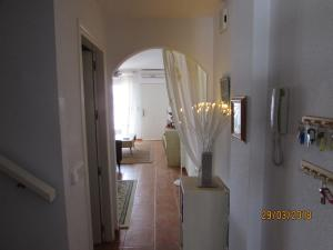 A television and/or entertainment centre at No.19 Palomares