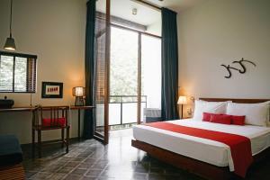 A bed or beds in a room at Villa Ni Say