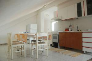 Cucina o angolo cottura di Acqualadroni Affitti