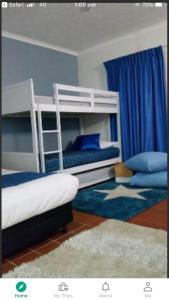 A bunk bed or bunk beds in a room at Resort Living