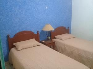A bed or beds in a room at Casa Osvi