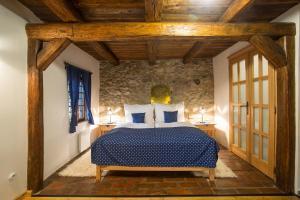 Postel nebo postele na pokoji v ubytování ANTIK