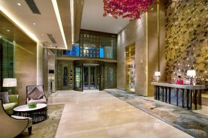 The lobby or reception area at THE ONE Executive Suites Managed by Kempinski - Shanghai