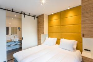 Een bed of bedden in een kamer bij Hotel Kaap West
