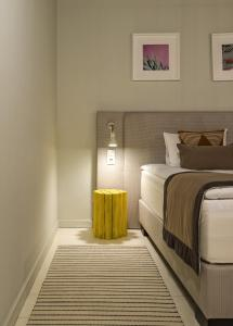 A bed or beds in a room at Art Village Club