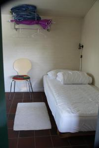 A bed or beds in a room at Krywilygaard Holiday Apartments