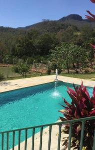 A view of the pool at fazenda Doce Sonhos or nearby