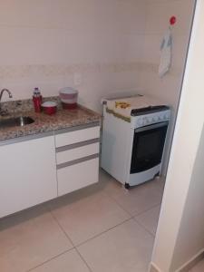 A kitchen or kitchenette at Condominio Vogo Mirage