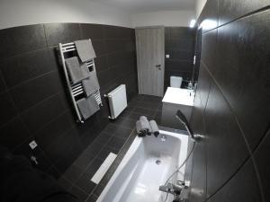 A bathroom at Airport Premium Apartments