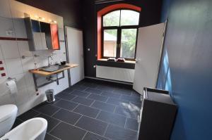 Ein Badezimmer in der Unterkunft MCM Comfort Apartments