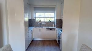 A kitchen or kitchenette at Albufeira Premium Apartment