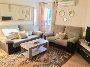 Гостиная зона в Marbella Apartment