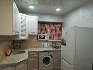 A kitchen or kitchenette at Апартаменты на Березовской