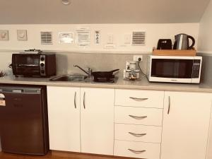 A kitchen or kitchenette at Stamps of Stanley