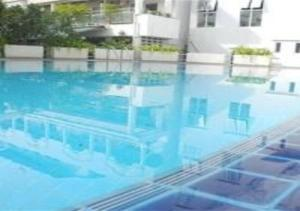 The swimming pool at or near Patong Tower 1-Bedroom Apartment Full Sea View