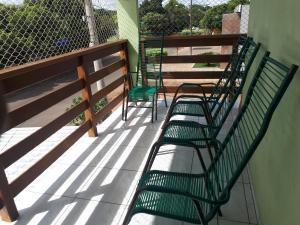 A balcony or terrace at Casa Ipê florido