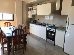 Kjøkken eller kjøkkenkrok på Reminiscenza