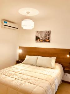 Una cama o camas en una habitación de BOULEVARD departamentos