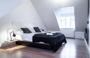 Rúm í herbergi á Luna Apartments - Laugavegur 37