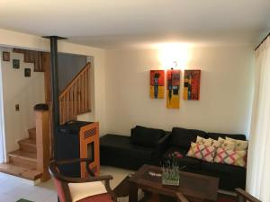 Zona de estar de Casa Nueva En Condominio Pucon