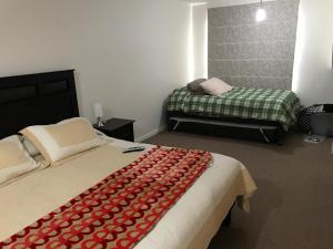 Cama o camas de una habitación en Casa Nueva En Condominio Pucon