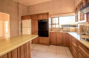 A kitchen or kitchenette at Zaria Sun