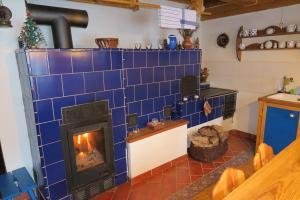 Kuchyň nebo kuchyňský kout v ubytování Roubenka U Milánka