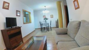 A seating area at Apartamentos Vacacionales Atlanterra