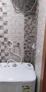 A bathroom at Roh Al Aseelah Furnished Units