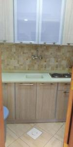 A kitchen or kitchenette at Roh Al Aseelah Furnished Units