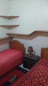 A bed or beds in a room at Casa para aluguel de verão