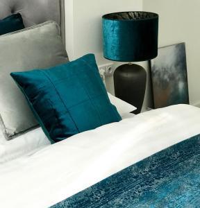Postel nebo postele na pokoji v ubytování Apartmány Mia Valtice