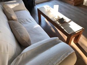 A bed or beds in a room at La Bella Escondida