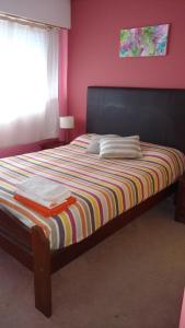 Una cama o camas en una habitación de Pilmaiquen II