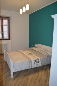 Letto o letti in una camera di Parravicini Red Flower apartment