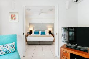 A bed or beds in a room at Mantra Aqueous on Port
