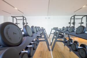 The fitness center and/or fitness facilities at DHH- Luxurious Quartz Residence Building 1 City Walk