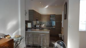 A kitchen or kitchenette at Villa Marjade