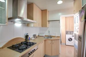 A kitchen or kitchenette at Lovely 3 Bed Apt w/Terrace & Balcony in Nou Barris