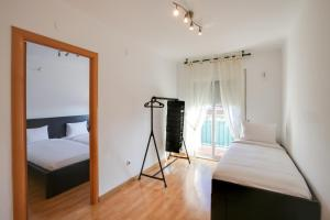 A bed or beds in a room at Lovely 3 Bed Apt w/Terrace & Balcony in Nou Barris