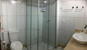 Koupelna v ubytování Condomínio Brisas do Amor