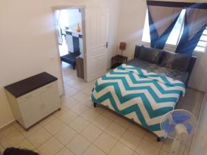 Ein Bett oder Betten in einem Zimmer der Unterkunft Residence Aito
