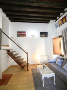 Area soggiorno di Apartamentos Toledo Suite