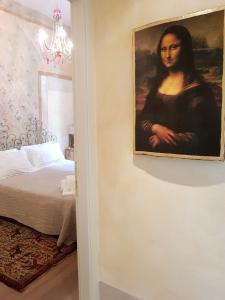 A bed or beds in a room at Appartamento Signoria