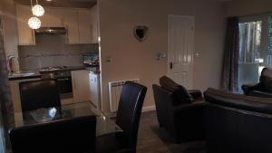 A kitchen or kitchenette at Valley Grove Bungalows