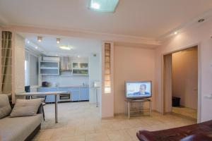 A television and/or entertainment center at Nice Flats Noviy Arbat